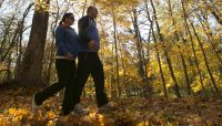 two people enjoying fall colors on the Des Plaines River Trail