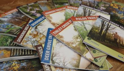a pile of Forest Preserves print maps