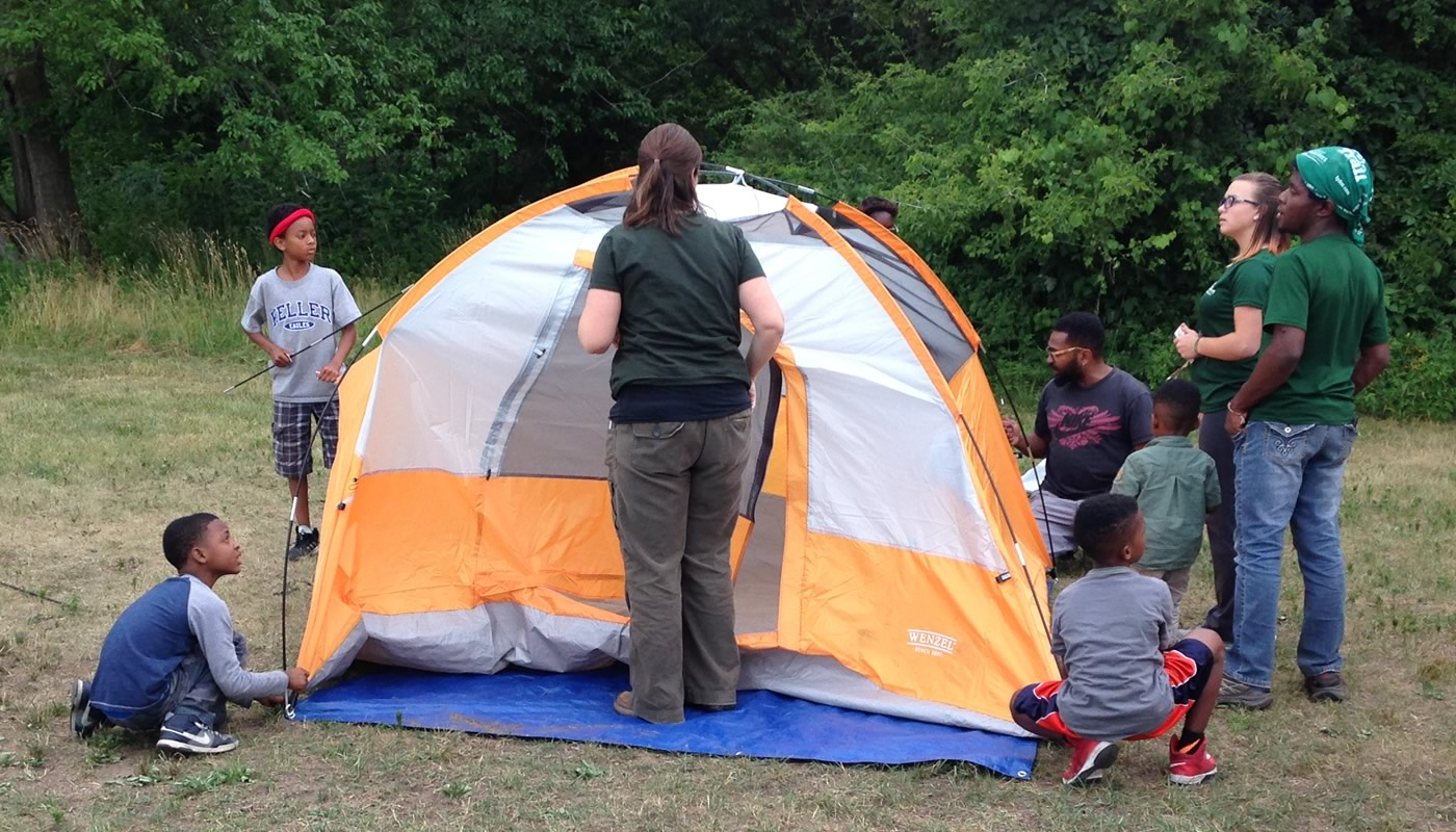people setting up a tent at a Camping 101 event