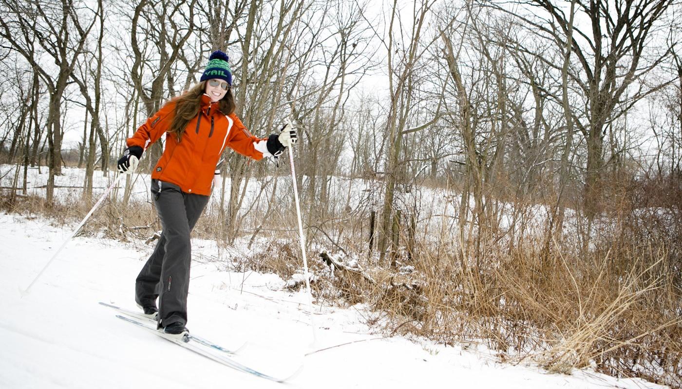 a person cross-country skiing at Sagawau Environmental Learning Center