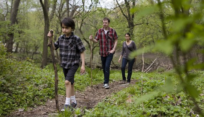 a family hiking at Trailside Museum