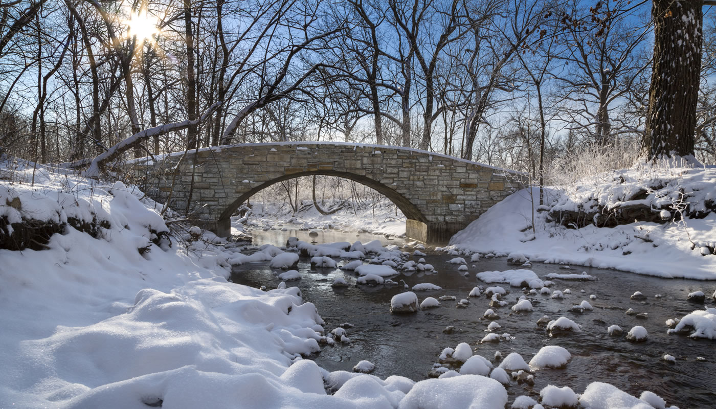 a creek and bridge in winter at Black Partridge Woods