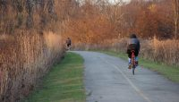 Bike riders on the Poplar Creek Trail System's Red Paved Loop