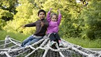 two children in the nature play area at Crabtree Nature Center