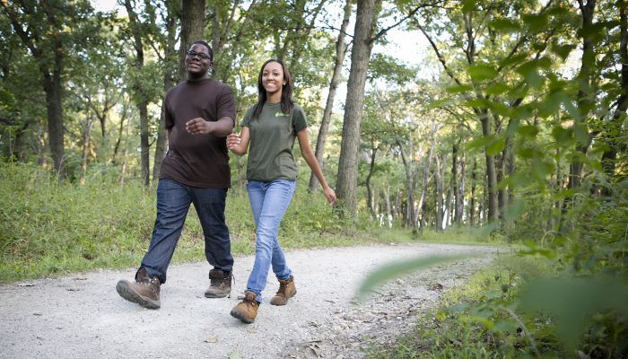 two people hiking on the Palos Trail System