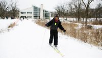 a skier at Sagawau Environmental Learning Center