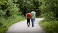 two people walking on the Salt Creek Trail System