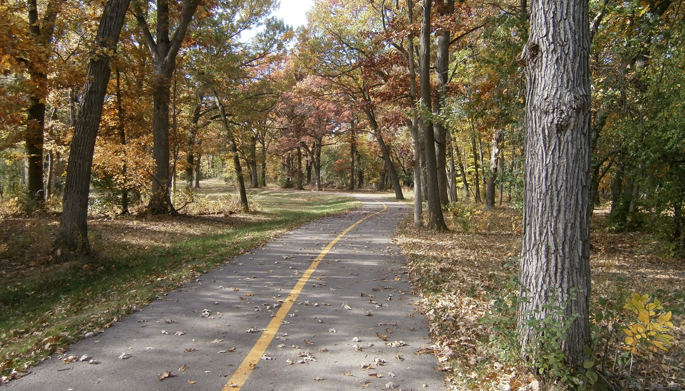 a stretch of paved trail on the Thorn Creek Trail System