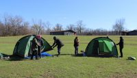 People setting up two tents during a CLIC training at Camp Sullivan.