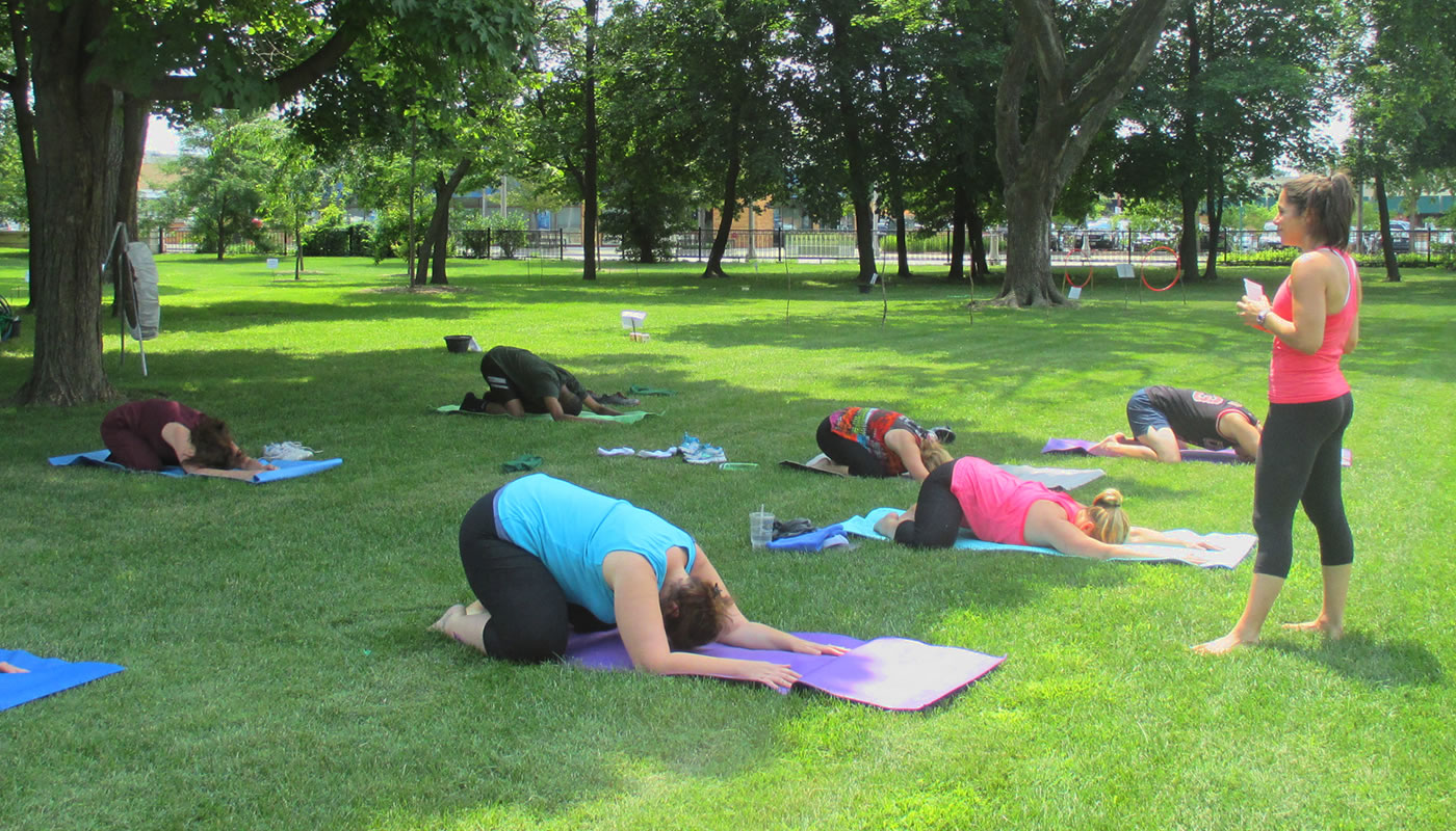 people participating in an outdoor yoga class