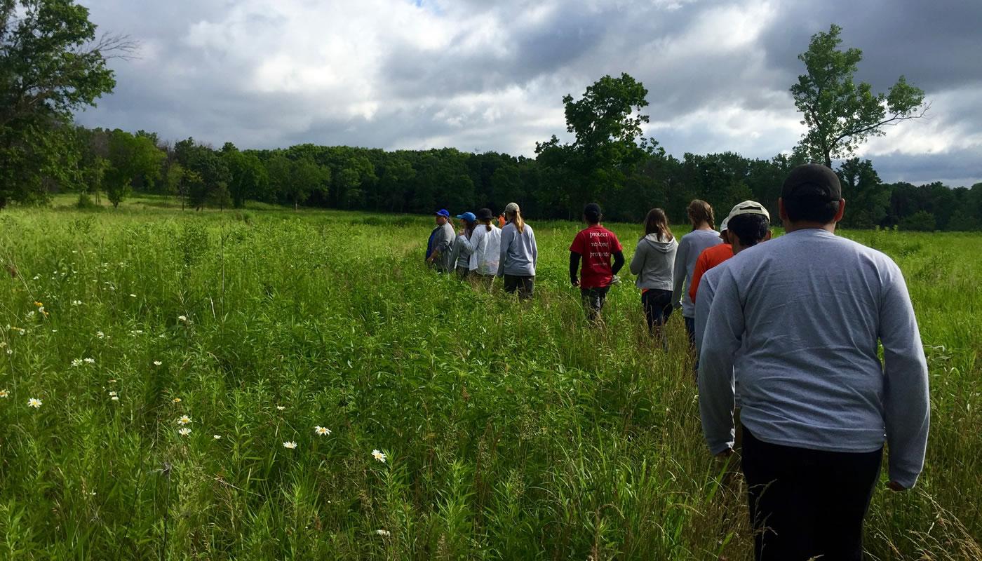 a group walks through a prairie
