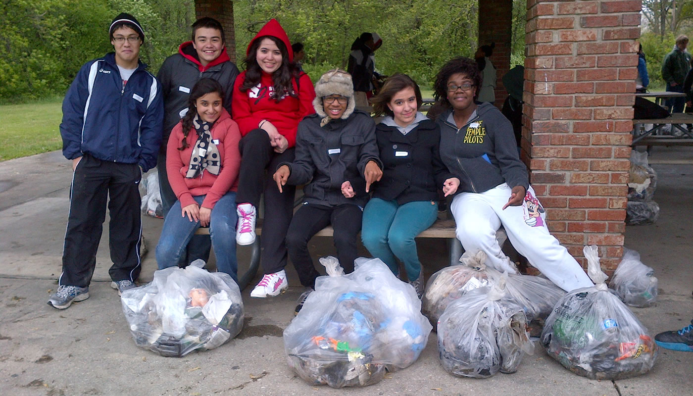 a group of volunteers with full trash bags