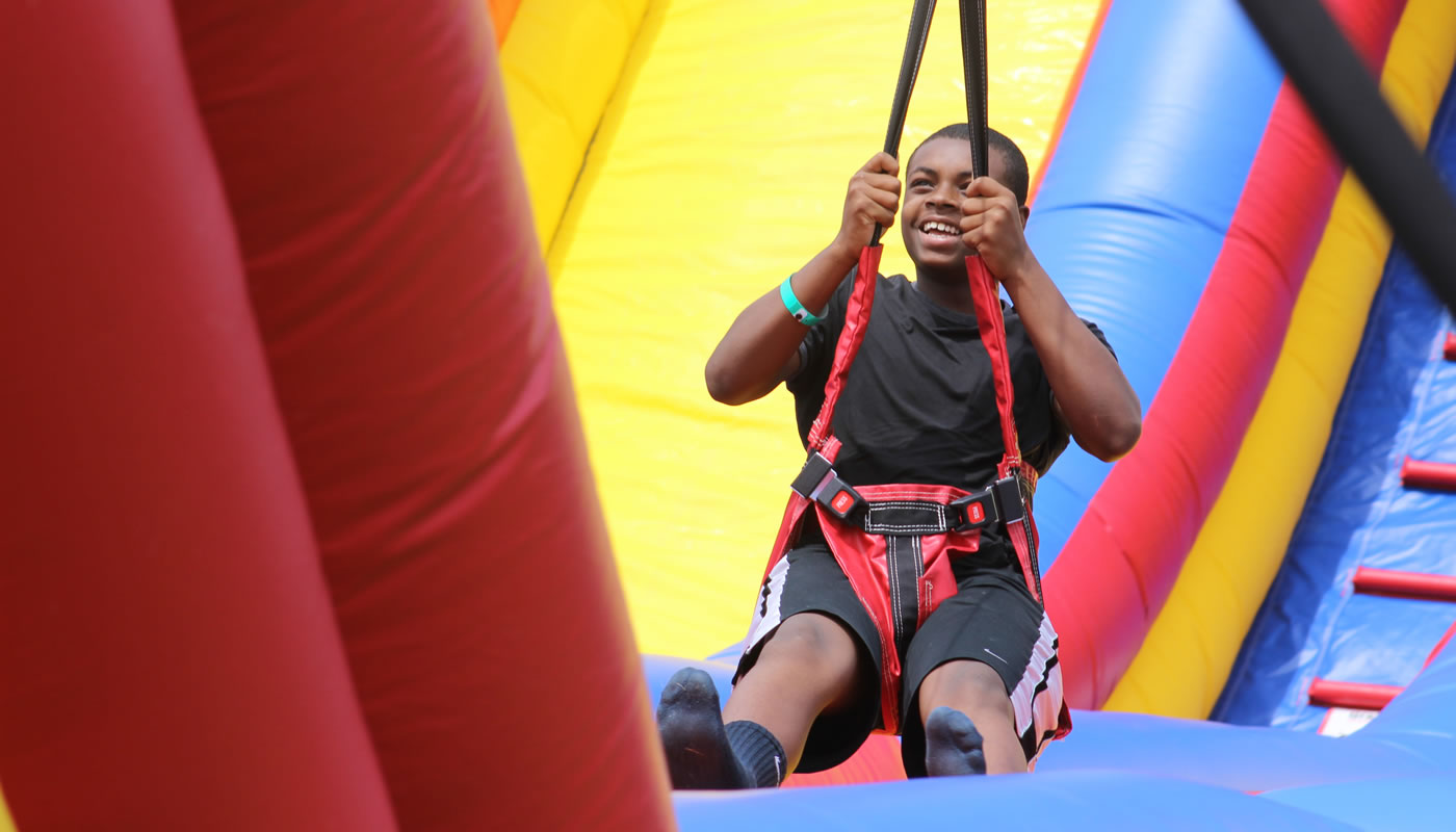 a person on an inflatable zip line run