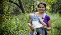 a woman walking with her baby at LaBagh Woods