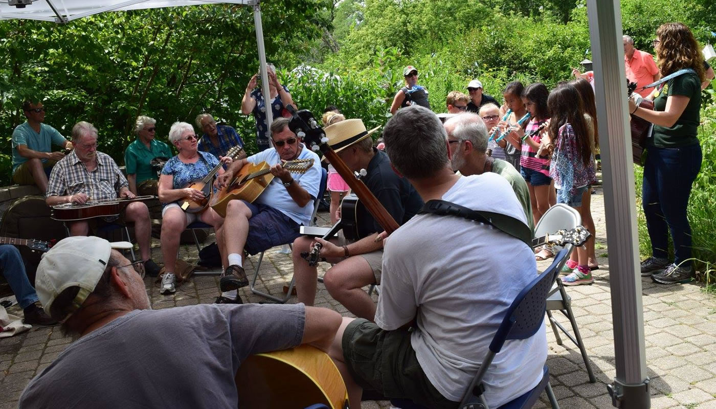people playing various instruments at a blugrass jam at Trailside Museum