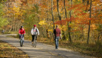People biking and walking on the North Branch Trail at Bunker Hill in fall.