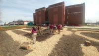 Students at Morton Freshman Center preparing their garden.