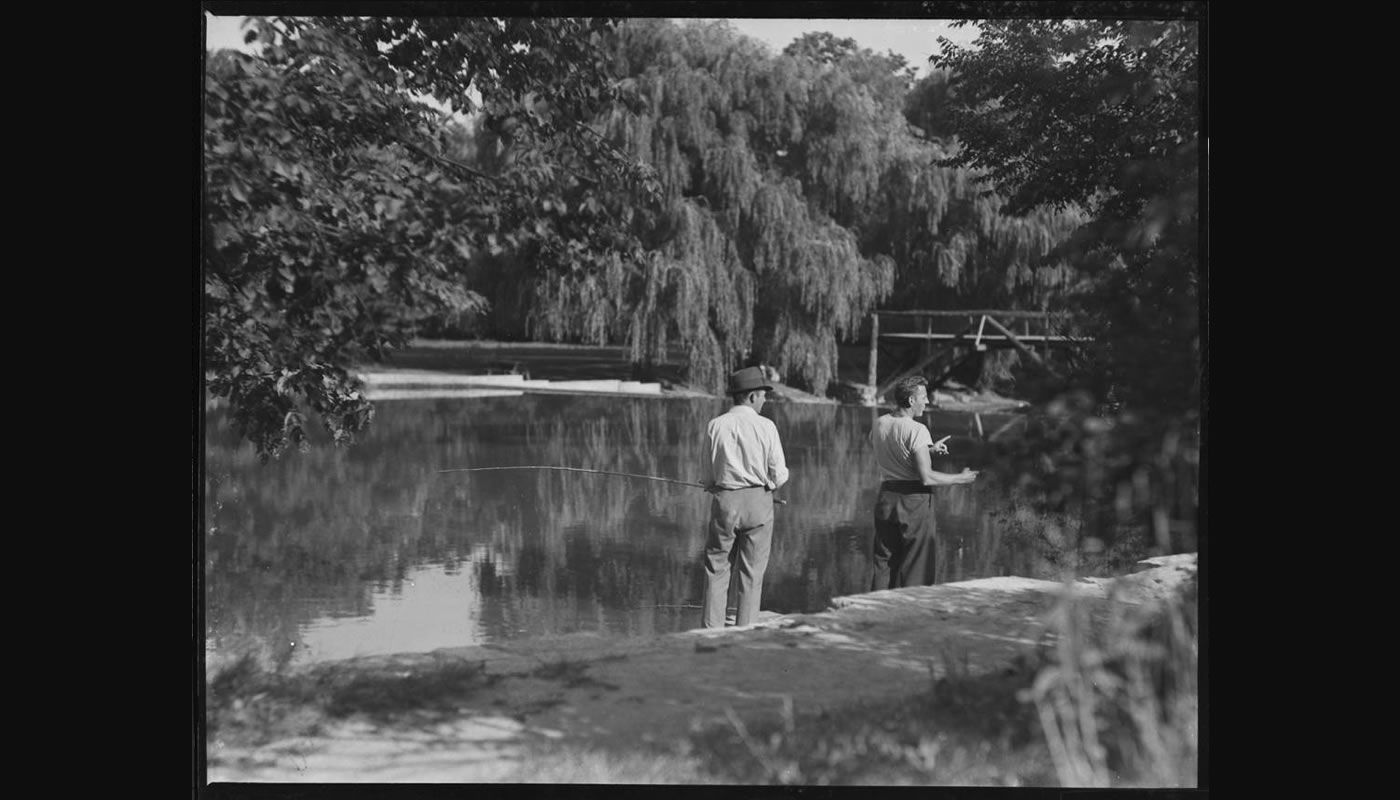 two people fishing in the Forest Preserves in the 1920s