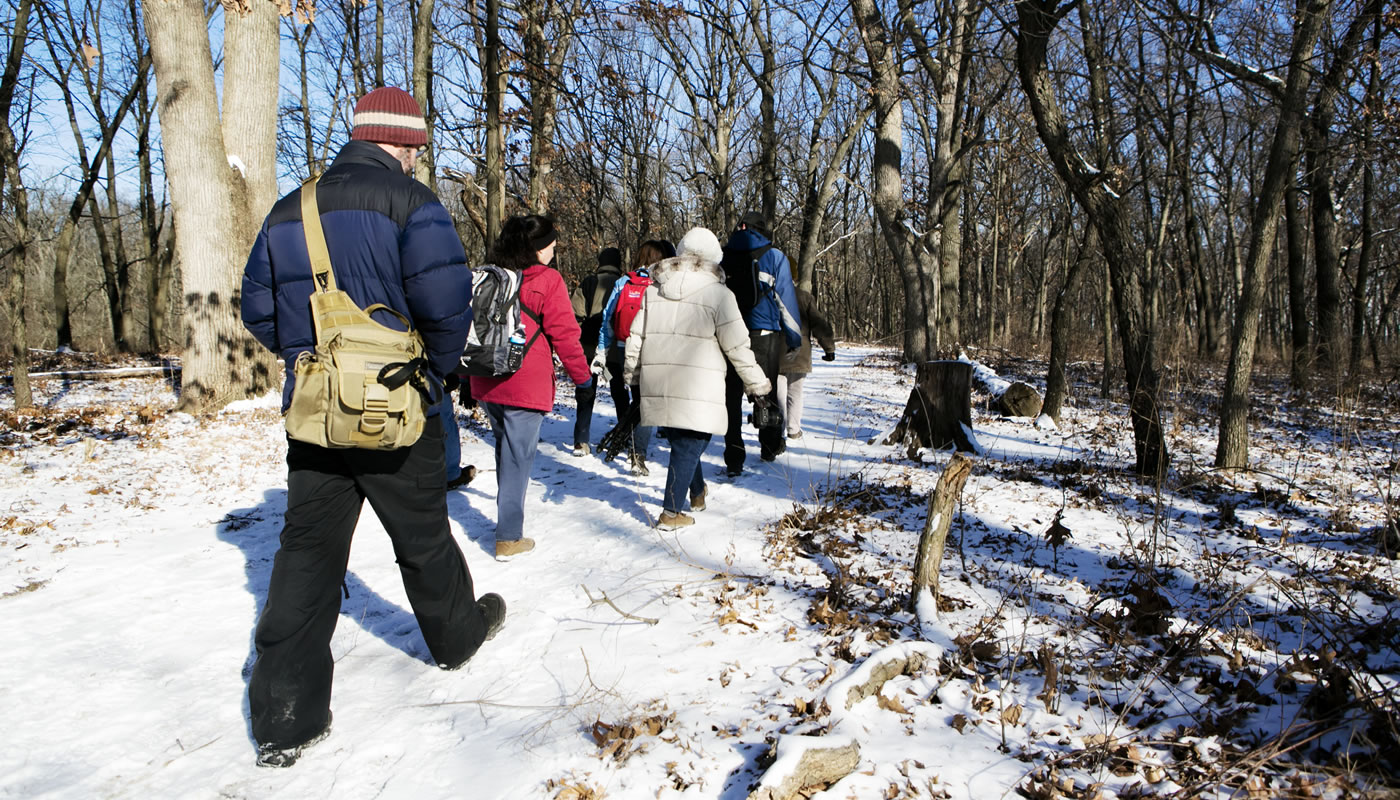 Hikers at Little Red Schoolhouse Nature Center in winter.