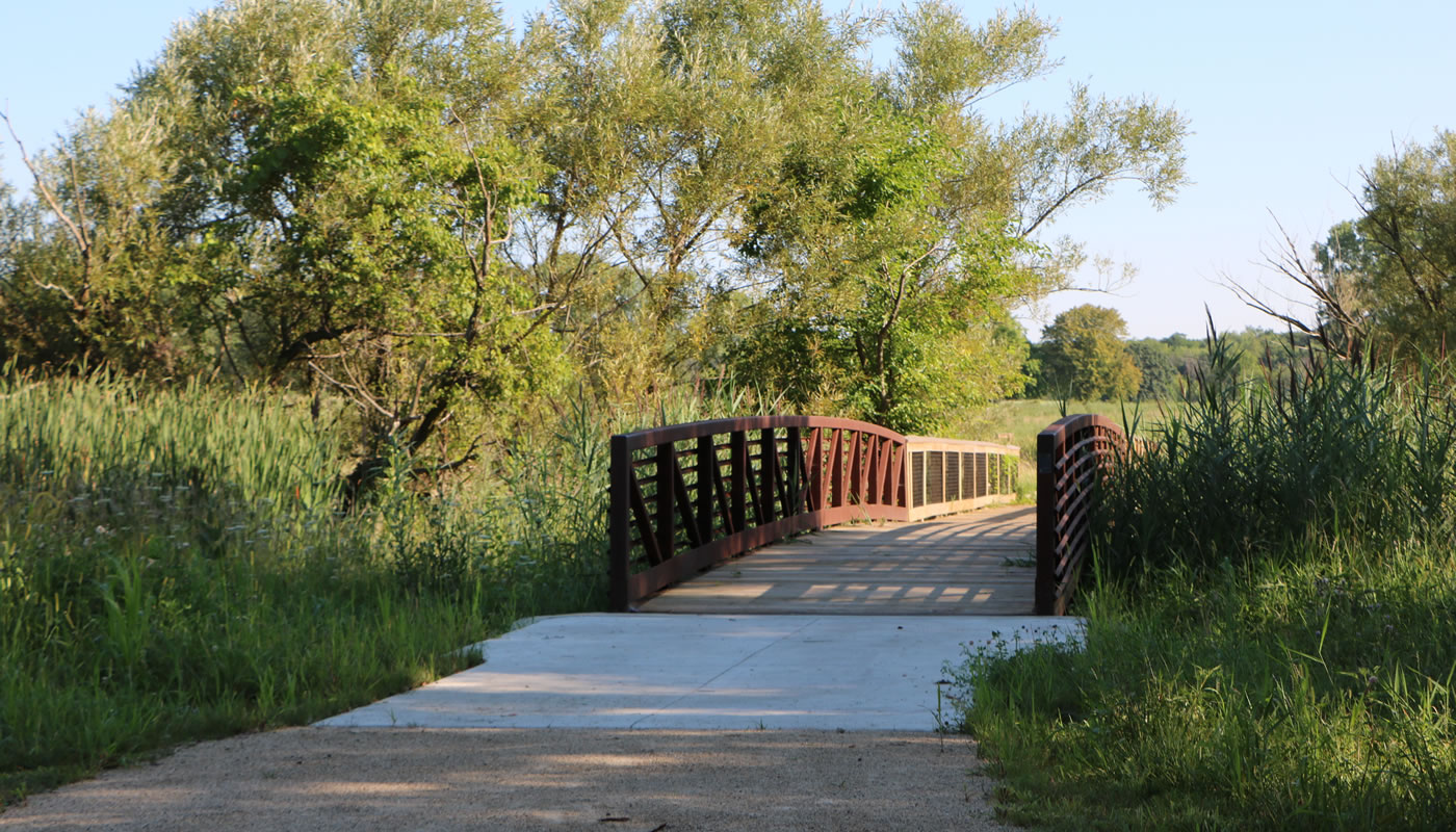 a trail and bridge at Oak Forest Heritage Preserve