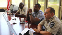 three Forest Preserves Police officers sitting at a training