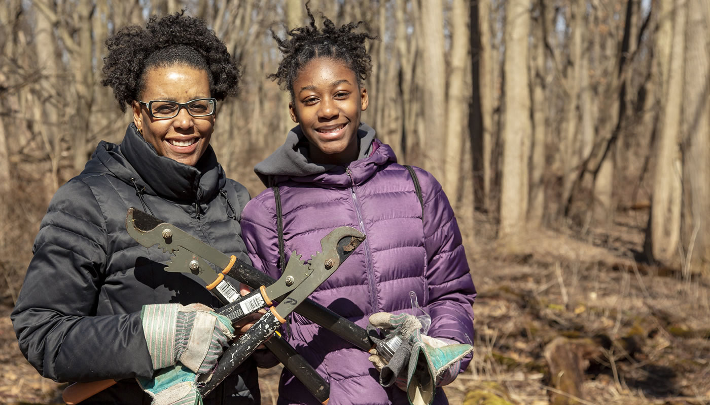 Lorrie and Kaitlyn James outside at a volunteer workday