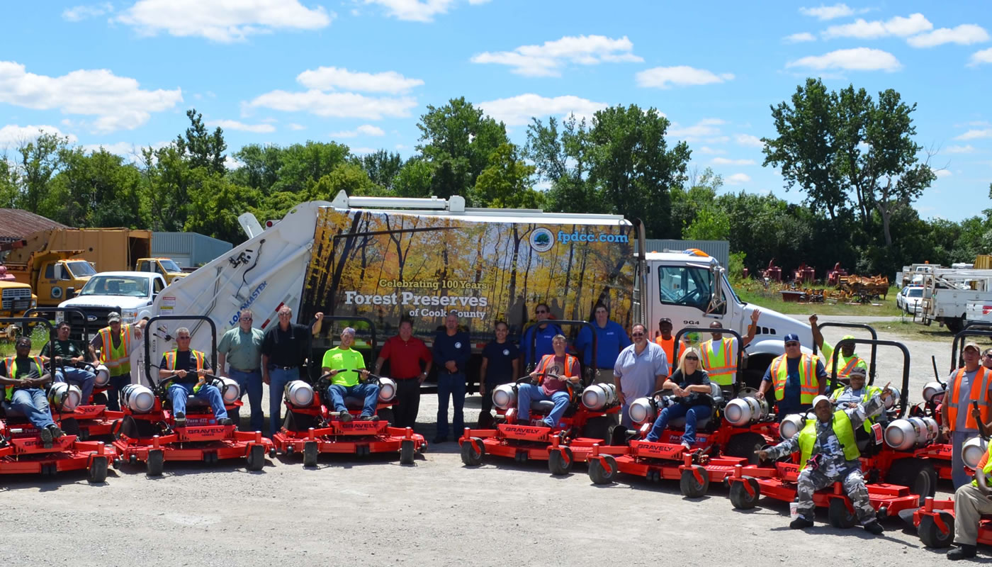 Forest Preserves employees posing with new propane mowers