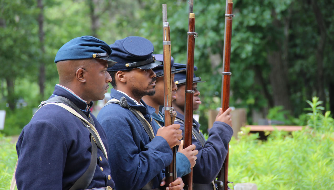 reenactors in Civil War military uniforms