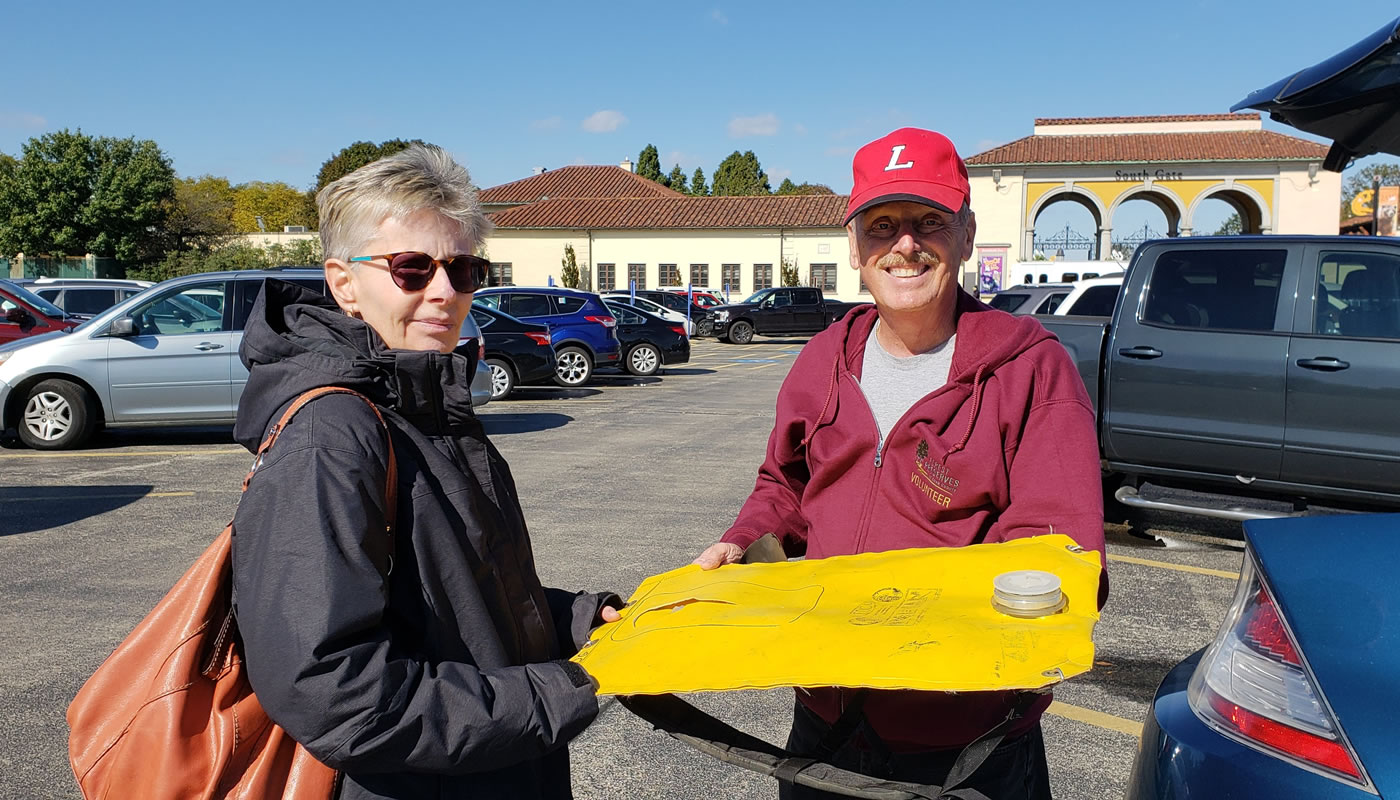 Two volunteers, Ellie Shunas and Lee Witkowski, holding a restoration tool