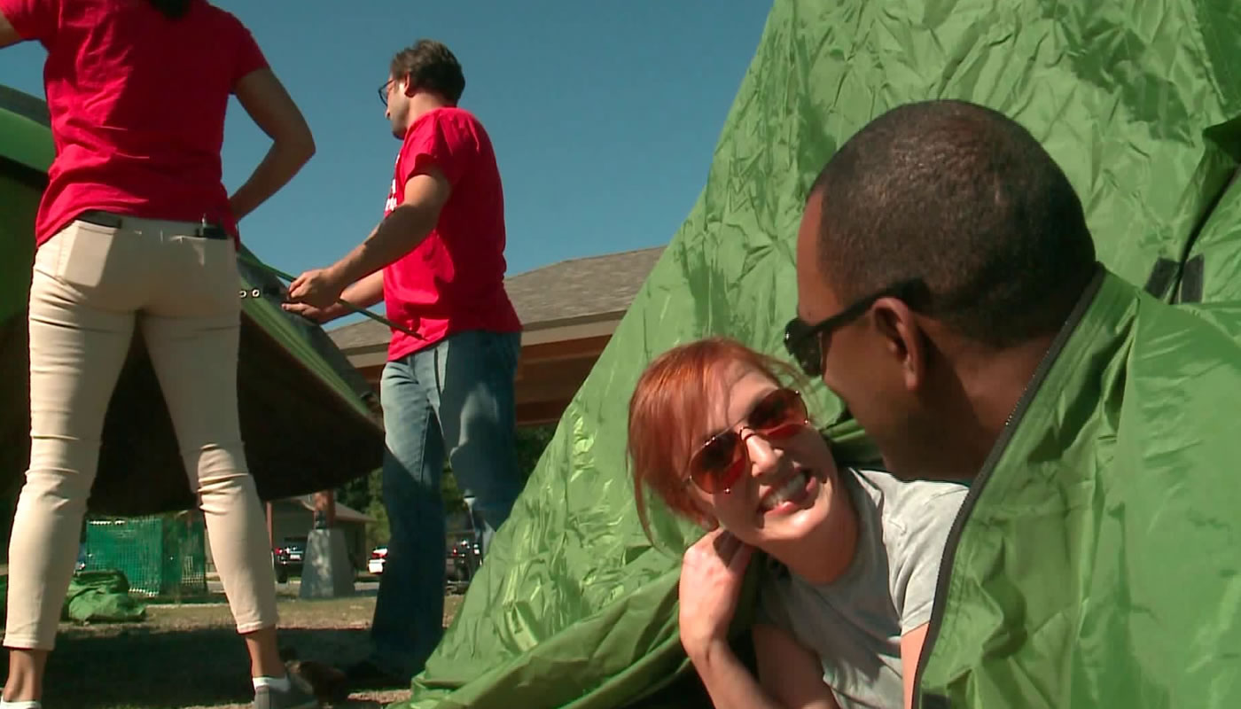 wgn anchors attempting to set up tents