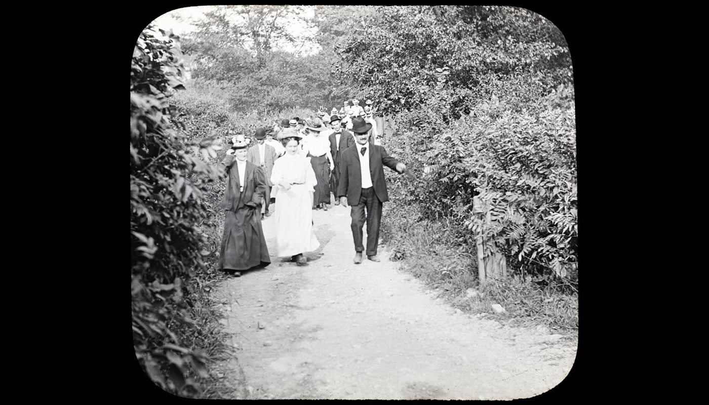 people walking along a nature trail in 1904