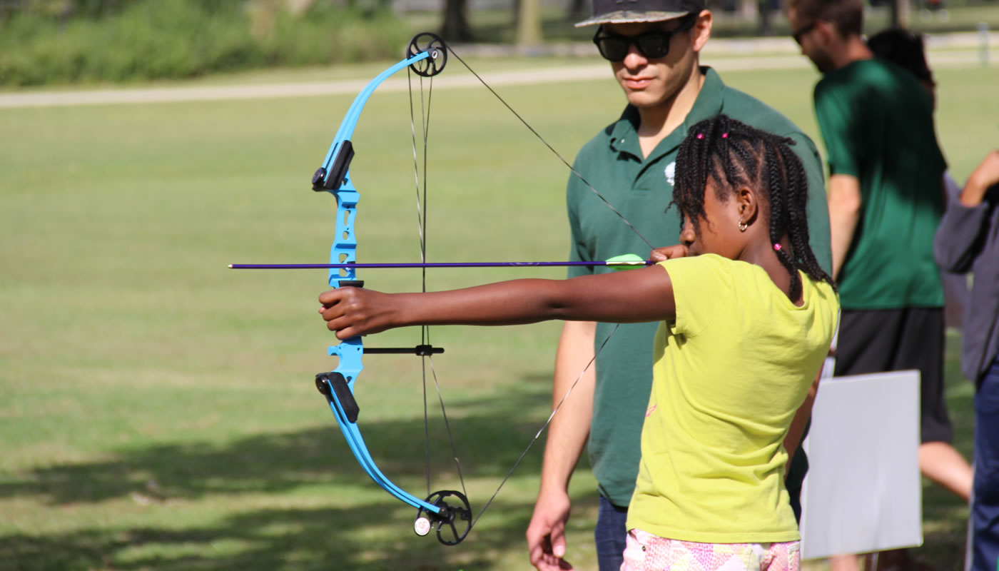 a girl participating in archery