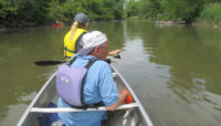two people in a canoe on the Little Calumet River