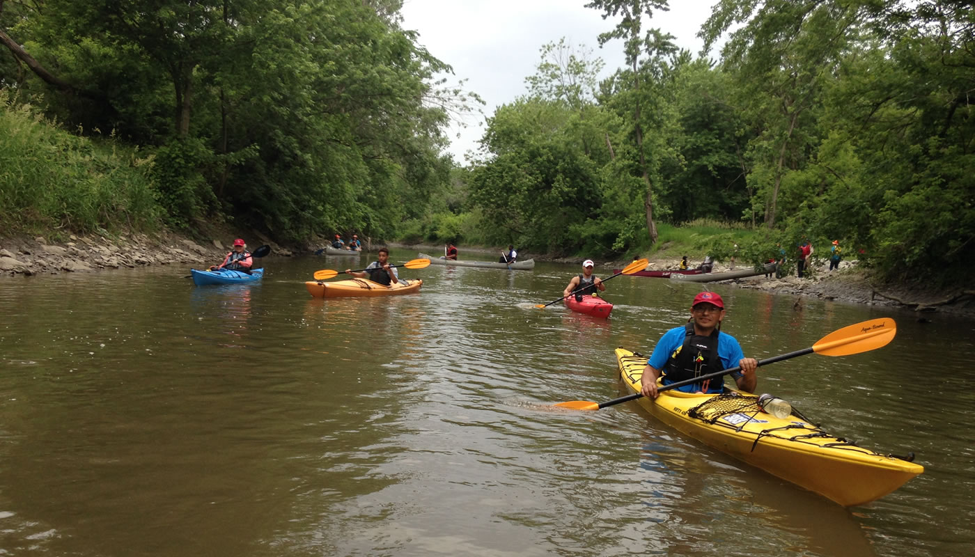 people in kayaks cleaning up the Little Calumet River