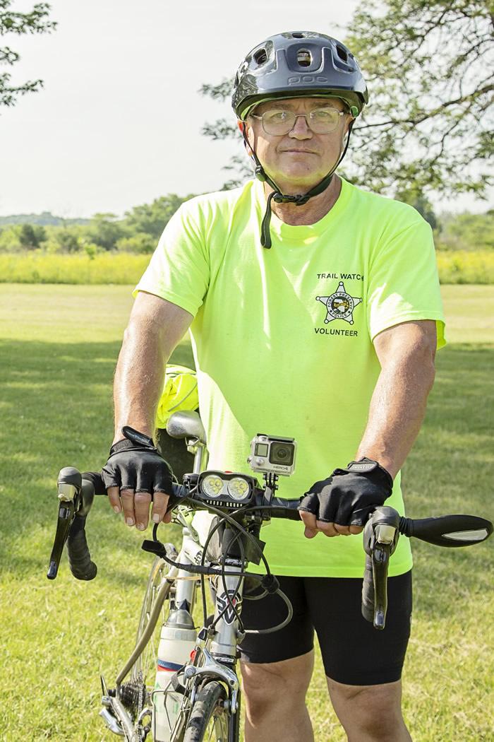 Joe Schlau with his bike on a Trail Watch Patrol