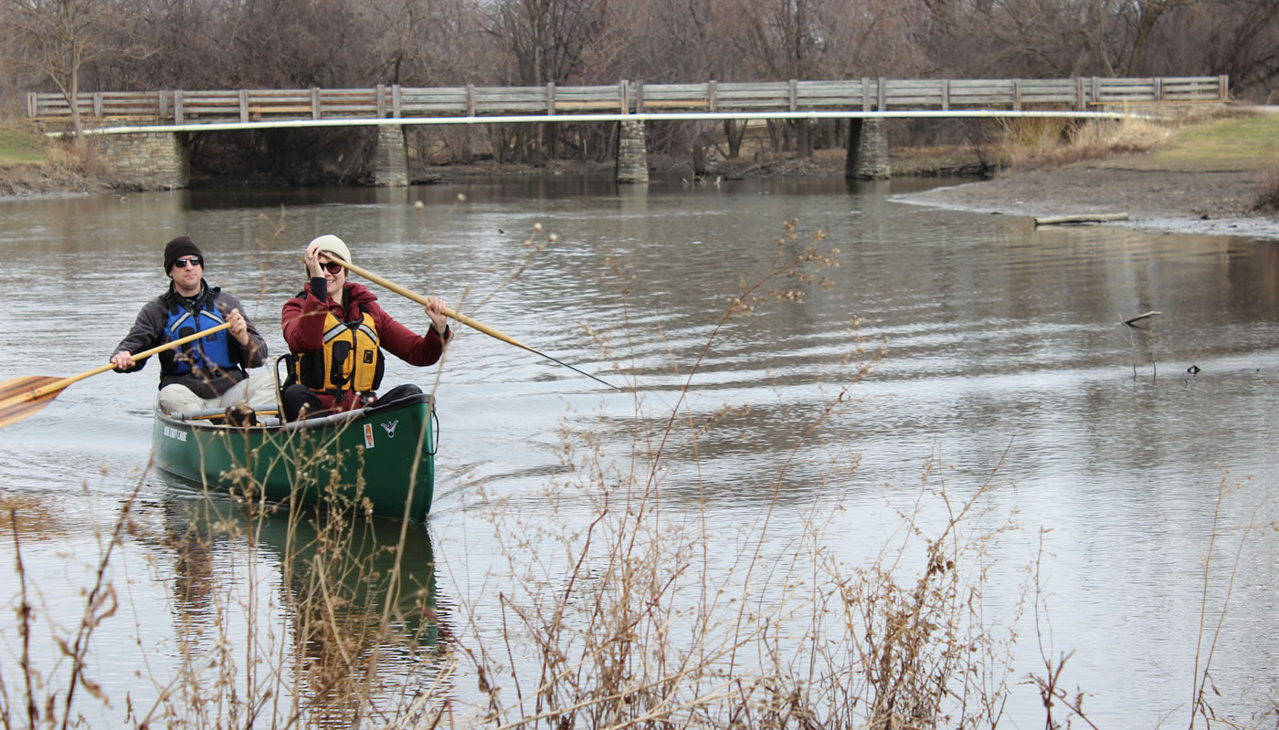 two people in a canoe on the North Branch of the Chicago River