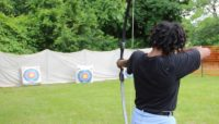 a person participating in archery at Beaubien Woods