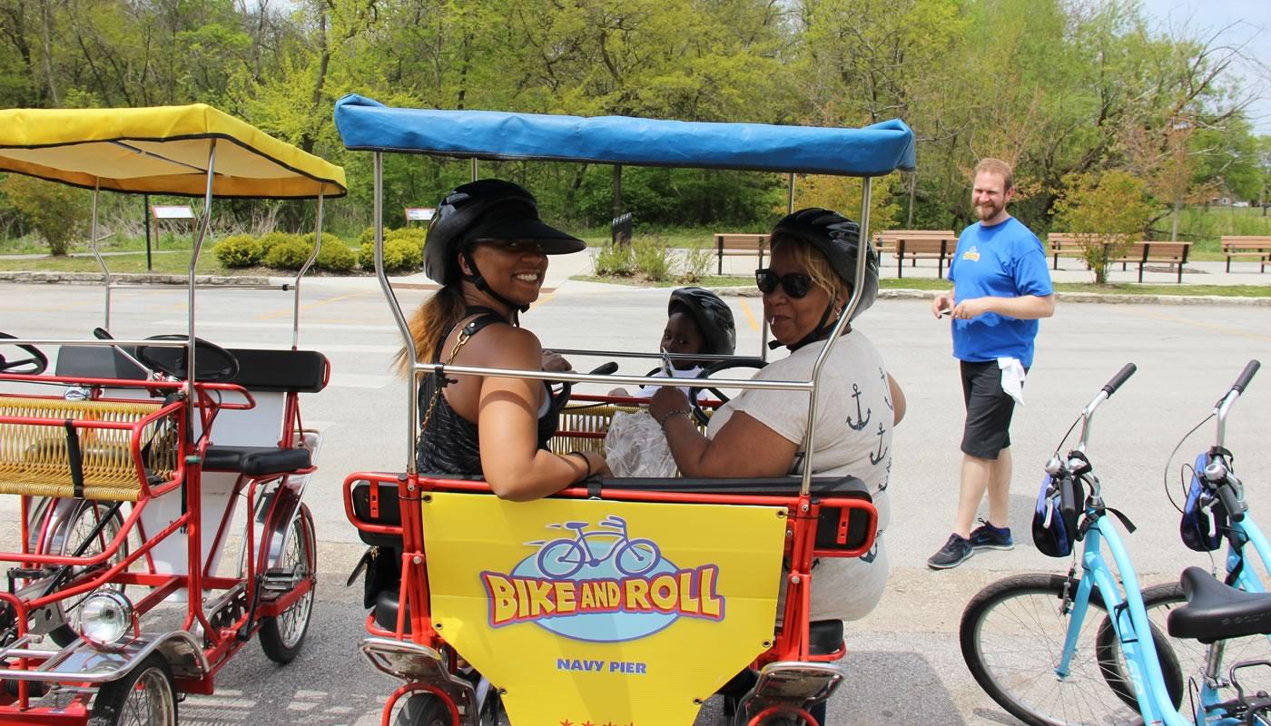 a family riding a quad bike at Eggers Grove
