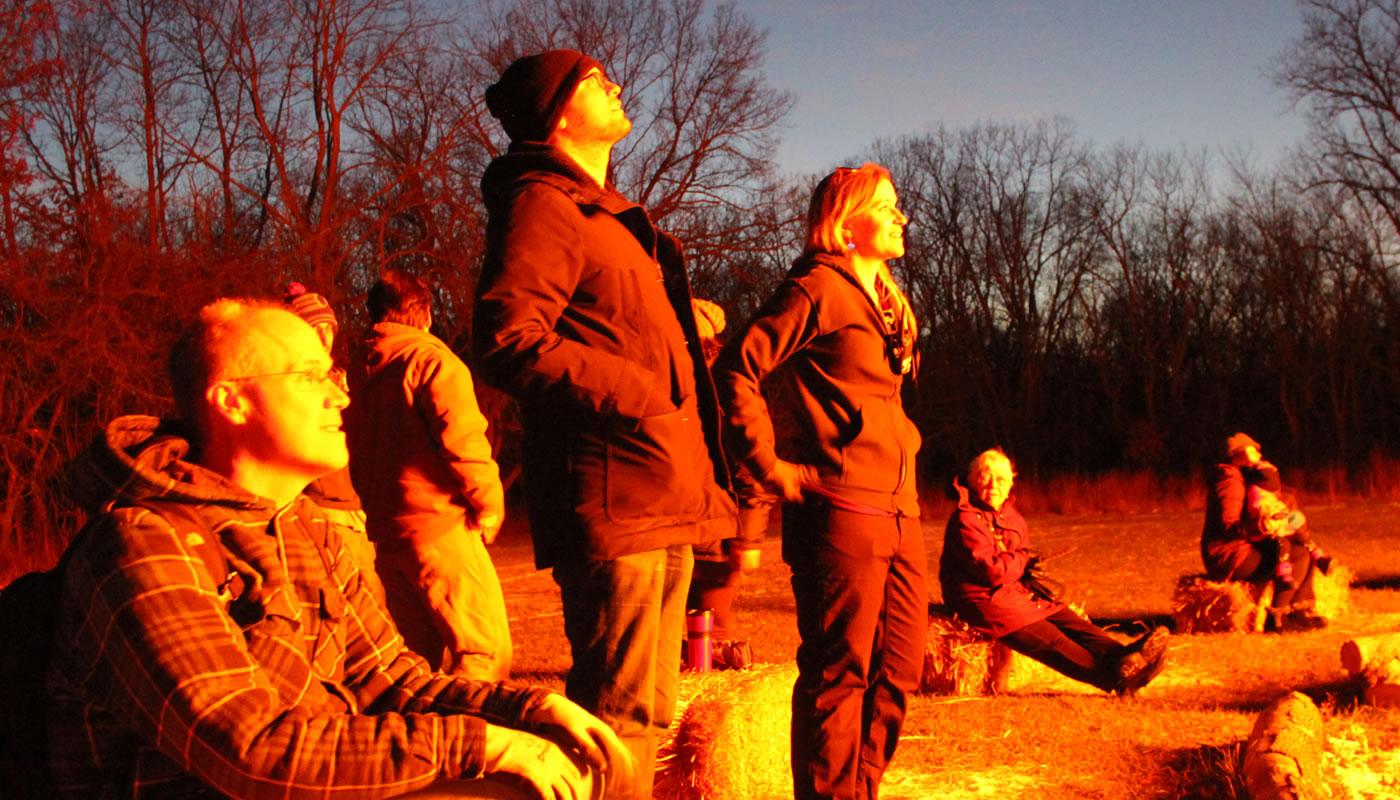 people looking at a bonfire at Camp Dan Beard