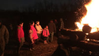 people around a bonfire at Camp Shabbona Woods