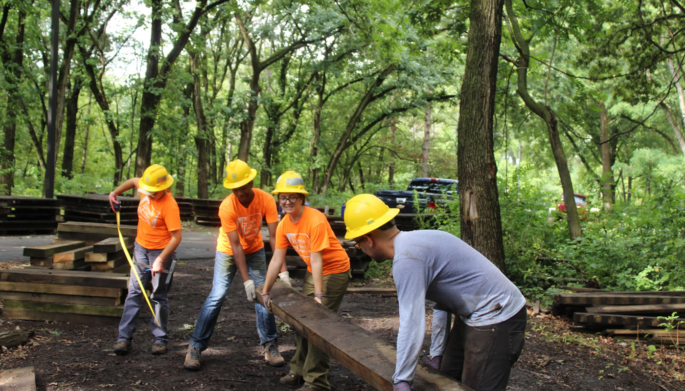 Chicago Conservation Leadership Corps crew members work on constructing a boardwalk