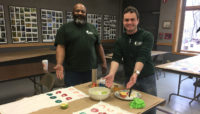two Forest Preserves staff members demonstrating print making techniques at Sand Ridge Nature Center