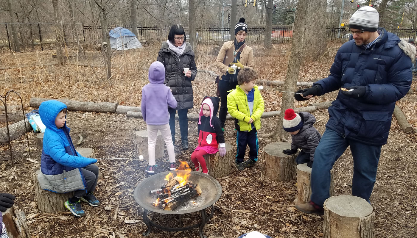 people around a campfire roasting marshmallows at Trailside Museum