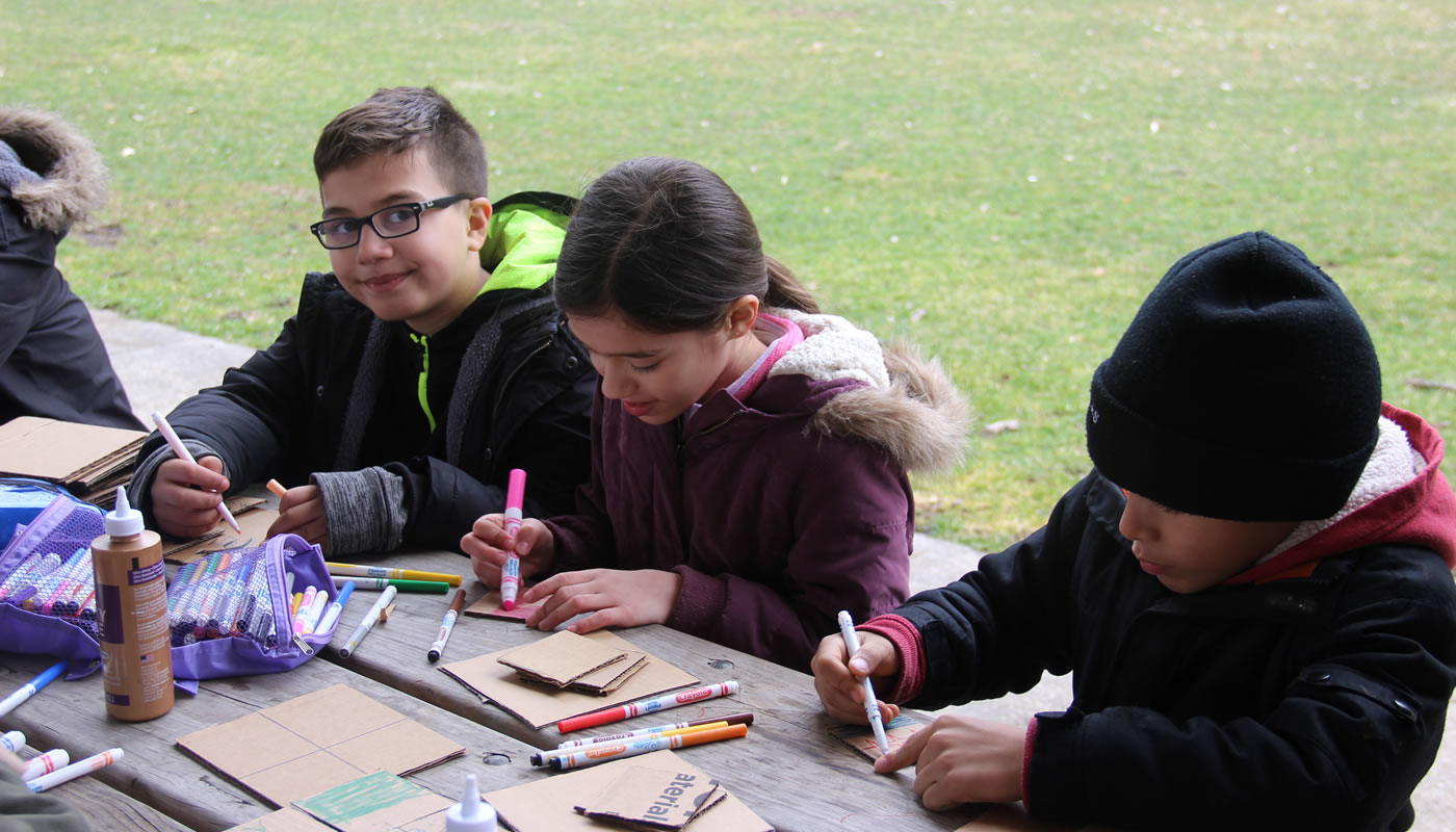 a group doing arts and crafts at Dan Ryan Woods