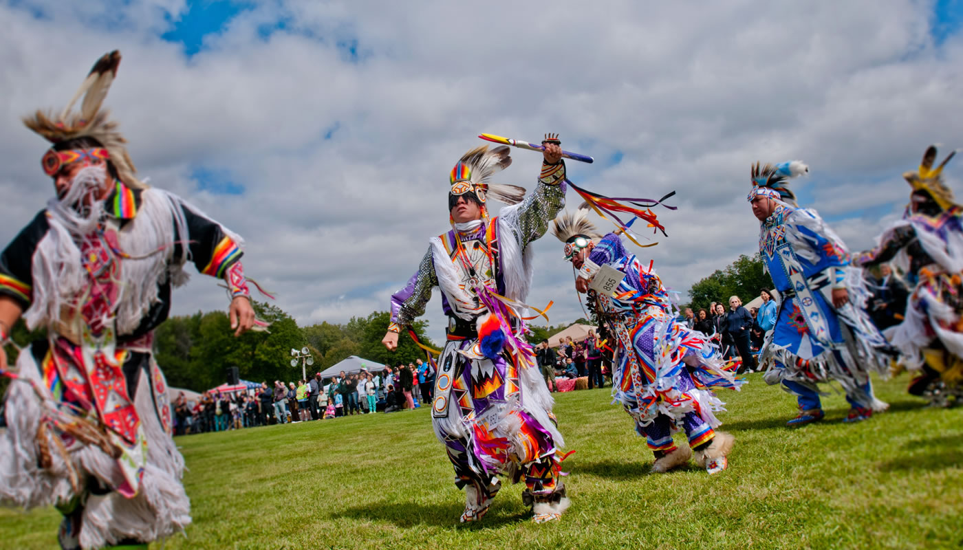 traditional grass dancers at the annual American Indian Center Chicago Powwow