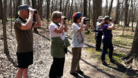 a group birding at Thatcher Woods