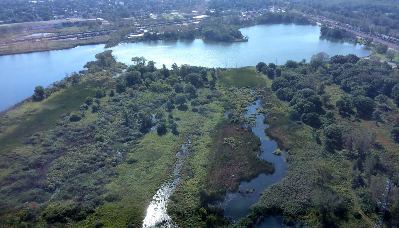 An aerial view of Powderhorn Lake and Powderhorn Prairie and Marsh Nature Preserve.