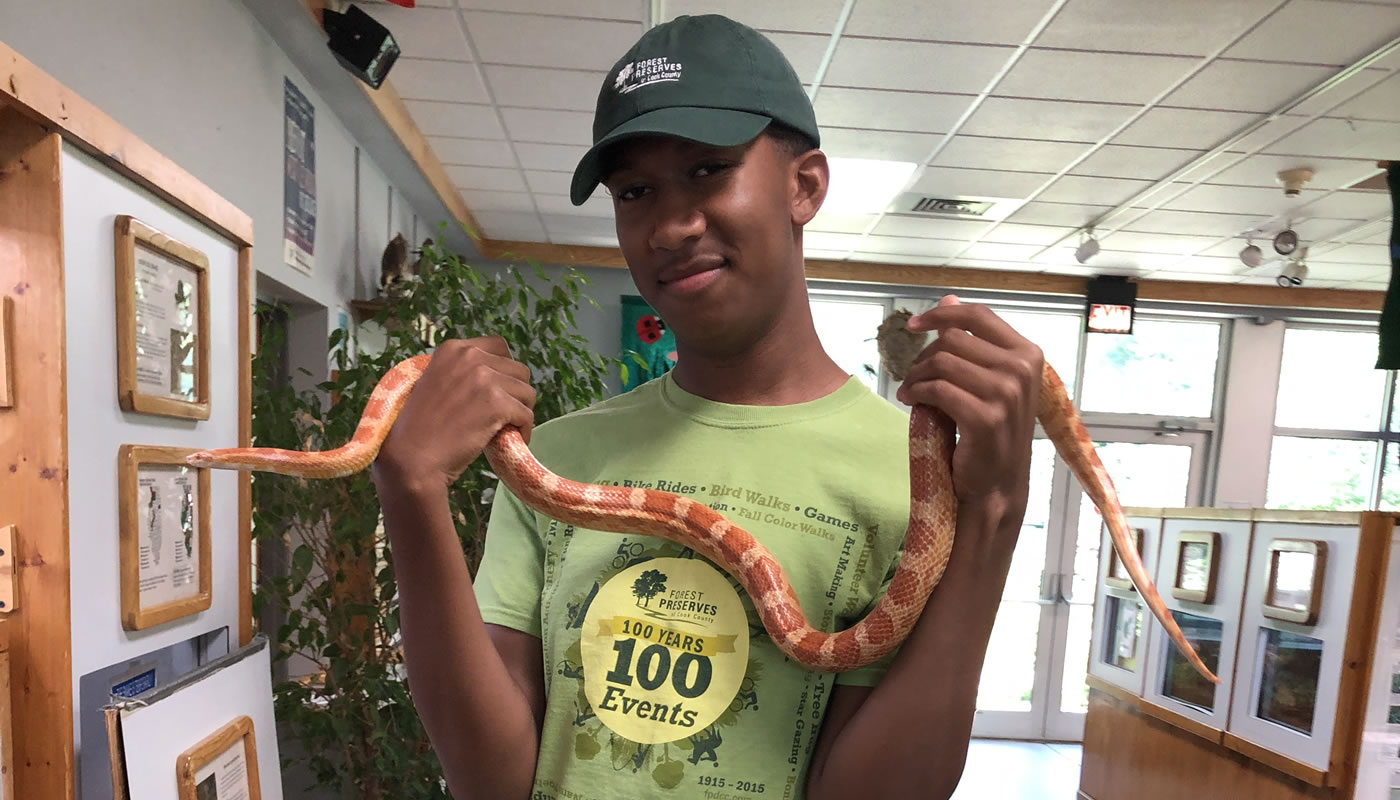 Brett Harris with a snake at a nature center