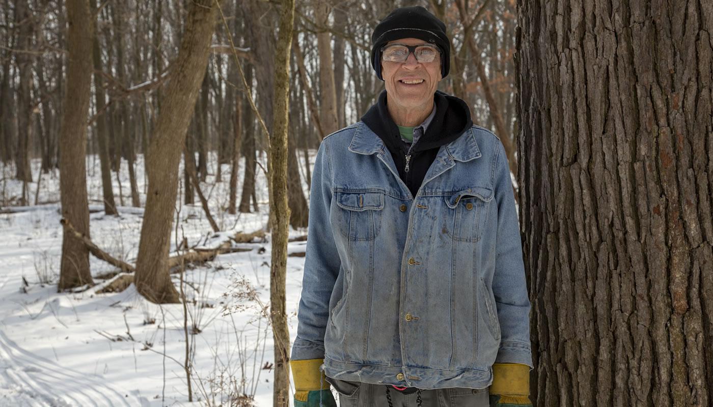 Jan Pietrzak volunteering in the Forest Preserves of Cook County