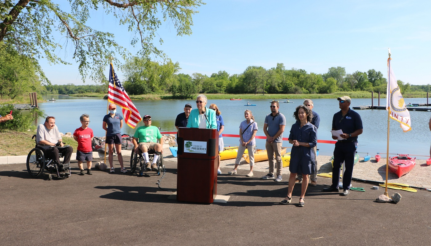 President Preckwinkle gives remarks during the Busse Lake Boat Lunch ribbon cutting ceremony